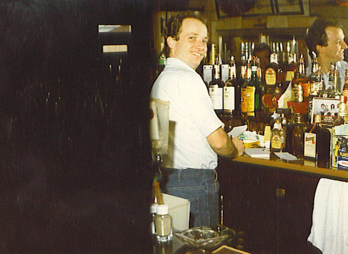 Branson-behind the bar